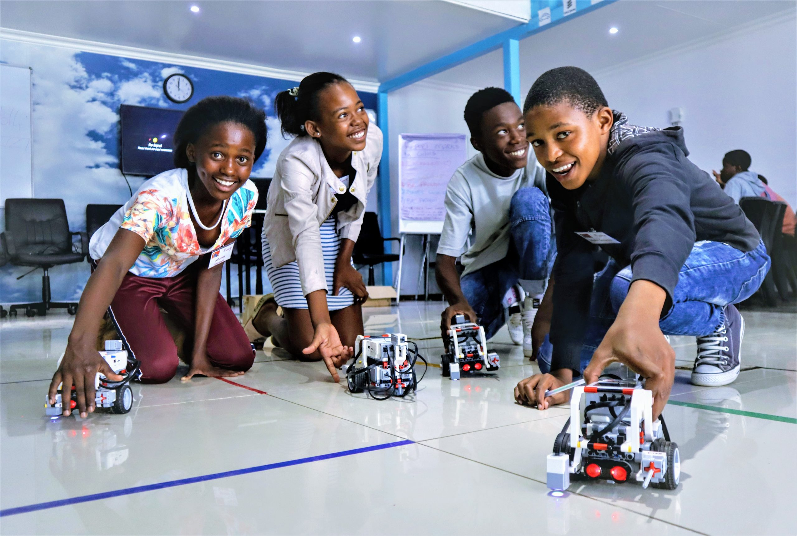 Digital lab kids posing with robots